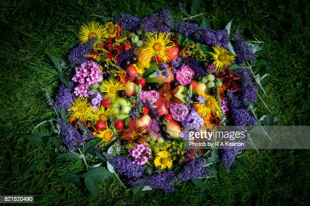 Colourful arrangement of fruits and garden flowers