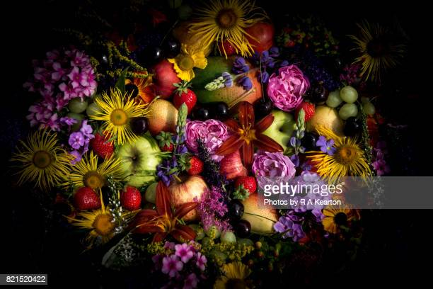 Colourful arrangement of summery fruits and flowers