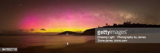 colourful aurora australis and milky way panorama over beach scene - aurora australis stock pictures, royalty-free photos & images