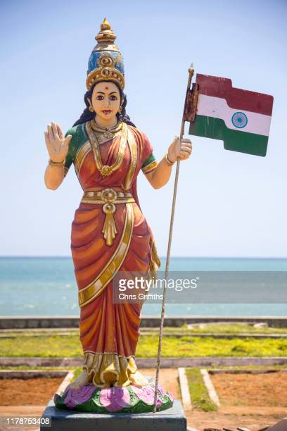 colourful baharat mata statue holding indian flag - tamil nadu stock pictures, royalty-free photos & images