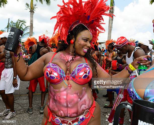 Colourful Bajan woman dancing in the street during the Crop Over festival in Bridgetown Barbados 5th August 2013
