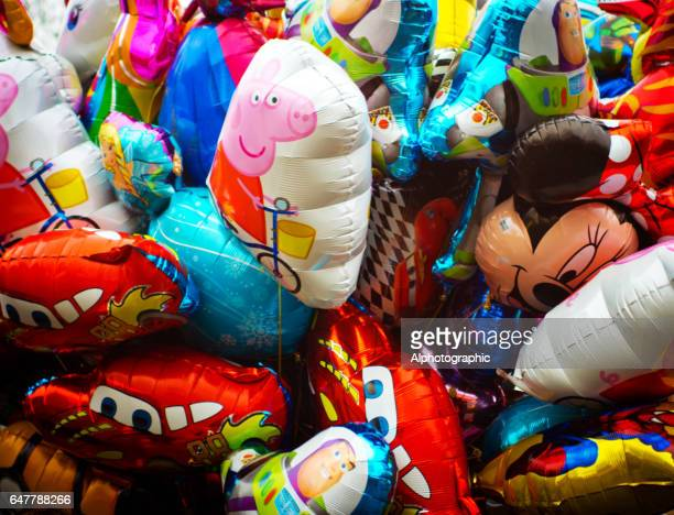 colourful balloons - peppa pig stock pictures, royalty-free photos & images