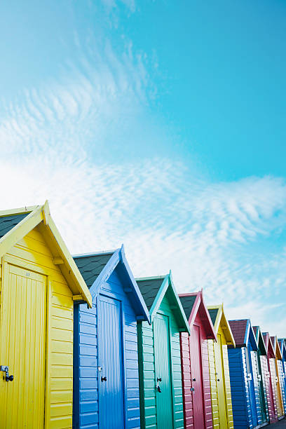 Colourful Beach Huts Along The Seafront Wall Art