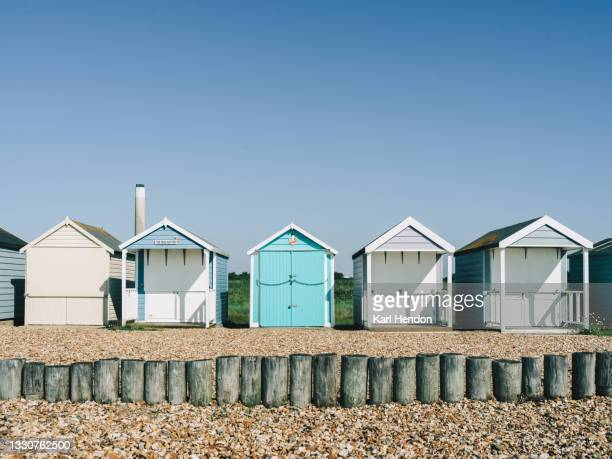 colourful beach huts at sunrise - stock photo - southampton england stock pictures, royalty-free photos & images