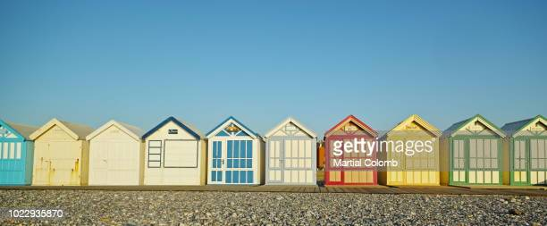 colourful beach huts - martial stock pictures, royalty-free photos & images