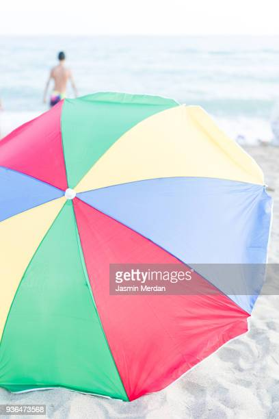 Colourful Beach Umbrella in Middle of Seaside