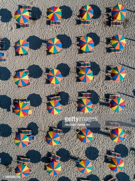 Colourful beach umbrellas shot from above, Veneto, Italy