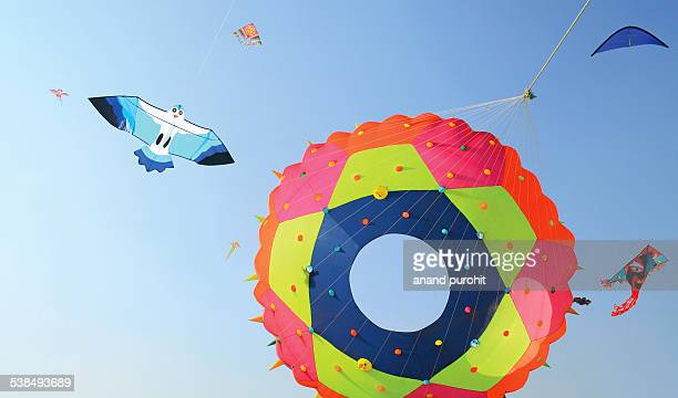 Colourful beautiful Kites flying in clear blue sky
