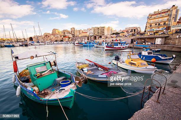 colourful boats at heraklion port - herakleion stock photos and pictures