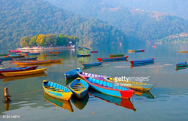 colourful boats in phewa lake, pokhara - pokhara stock pictures, royalty-free photos & images