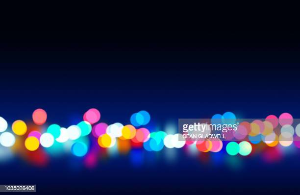 colourful bokeh lights from street lights and traffic - street light stock pictures, royalty-free photos & images