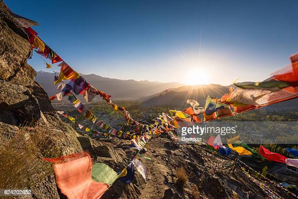 Colourful Buddhist prayer flags above Leh town in the Himalayan mountain, Leh Ladakh, India