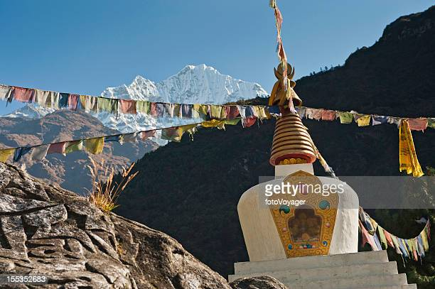 Colourful Buddhist prayer flags stupa Himalayas