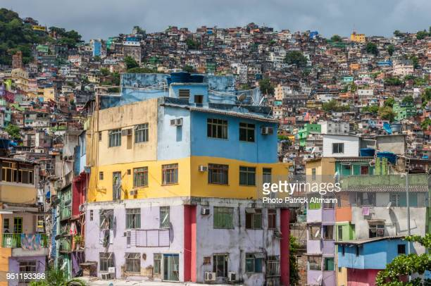 colourful buildings built on the steep hills, rio de janeiro's rocinha is largest shanty town (favela) in brazil - favela stock pictures, royalty-free photos & images