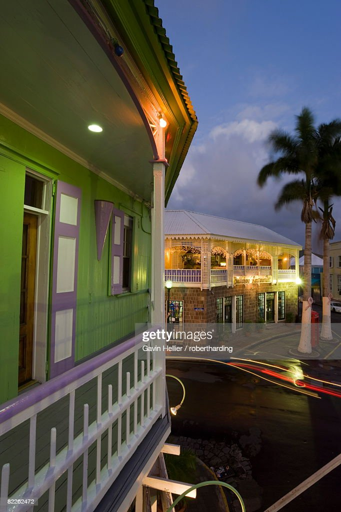 Colourful buildings surrounding the central Piccadilly Circus, illuminated at dusk, Basseterre, St. Kitts, Leeward Islands, West Indies, Caribbean, Central America : Stock Photo