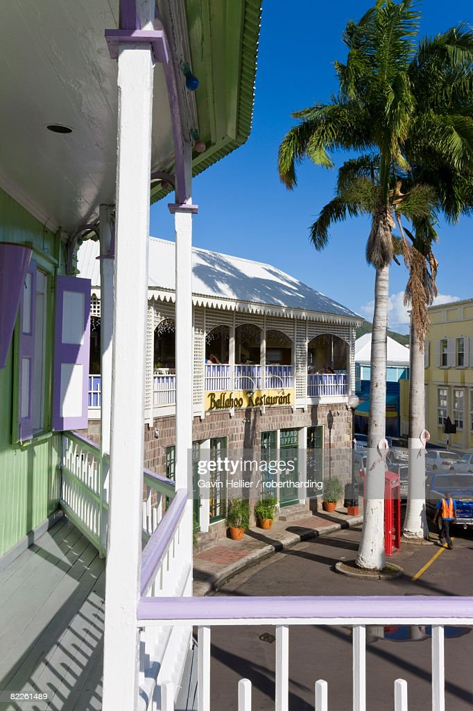 Colourful buildings surrounding the central Piccadilly Circus, Basseterre, St. Kitts, Leeward Islands, West Indies, Caribbean, Central America : Stock Photo