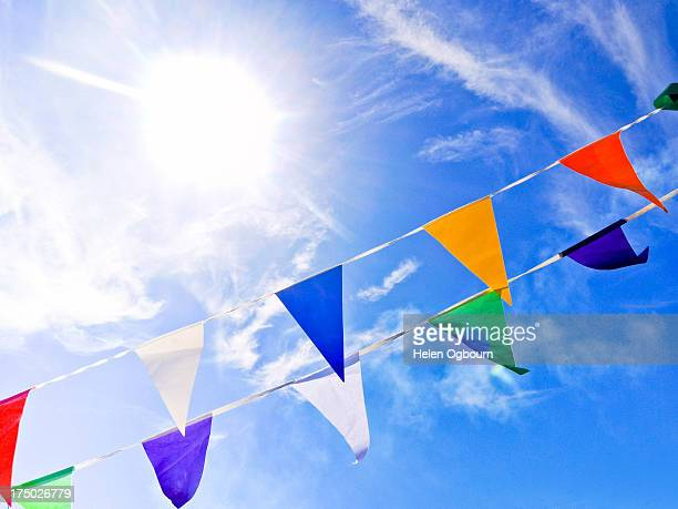 Colourful bunting against blue sky and sunshine
