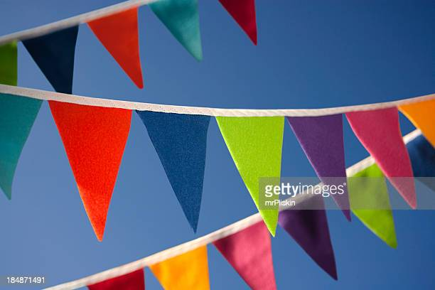 Colourful bunting against blue summer sky
