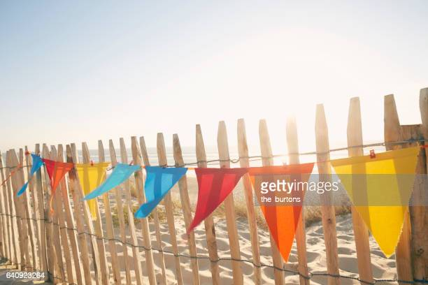 Colourful bunting flags for party decorations at beach