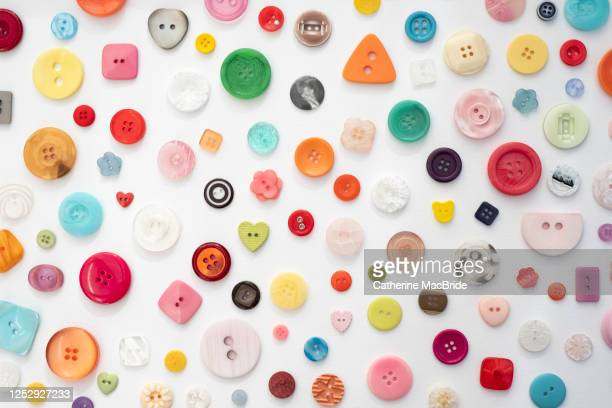 colourful button collection on a white background - catherine macbride stock pictures, royalty-free photos & images