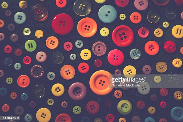 colourful buttons on a black background - catherine macbride fotografías e imágenes de stock