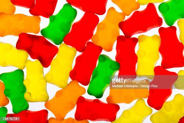 colourful candied gummy bears backlit - gummi bears stock photos and pictures