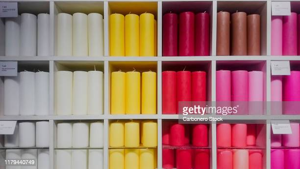 colourful candles stored - cifras financieras fotografías e imágenes de stock