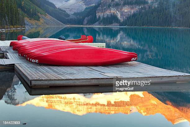 colourful canoes and mountain lake - chateau lake louise stock photos and pictures