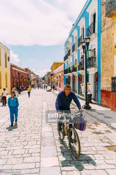 """colourful centric street in oaxaca (oaxaca state, mexico) - """"gerard puigmal"""" stock pictures, royalty-free photos & images"""