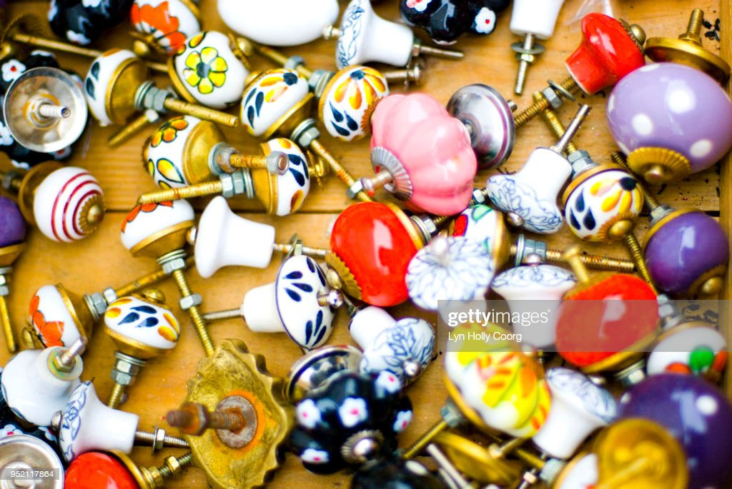 Colourful ceramic doorknobs for sale in marketplace : Stock Photo