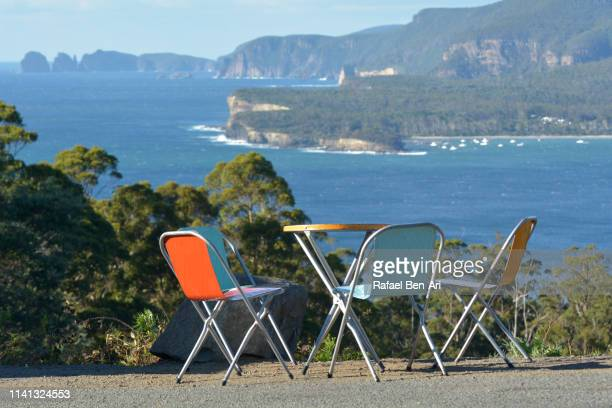 colourful chairs in pirates bay tasmania australia - rafael ben ari stock pictures, royalty-free photos & images