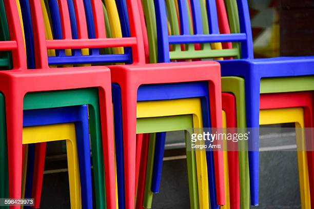 Colourful chairs stacked up