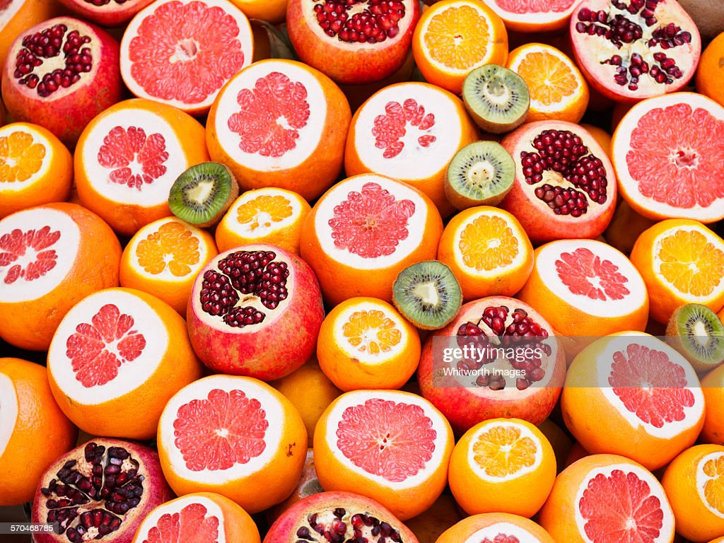 Colourful circles of fresh juicy fruit : Stock Photo
