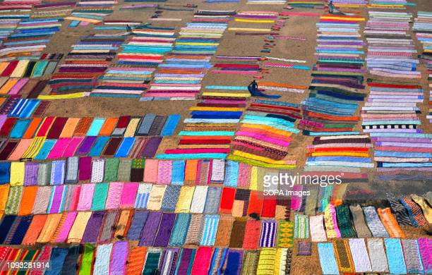 Colourful clothes being spread on the soil next to the river bank of Barakar in Jharkhand area The Dhobi Ghat of Kumardubi in the Jharkhand Province...