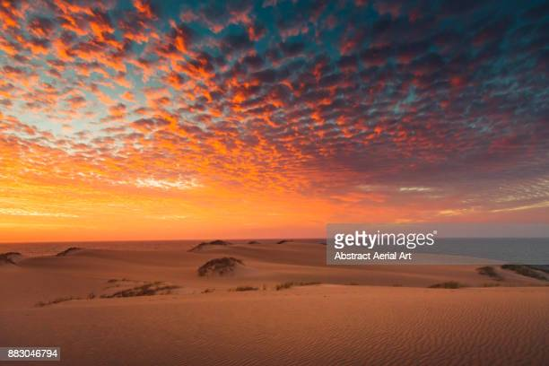 colourful clouds at sunset over the dunes - western australia stock pictures, royalty-free photos & images
