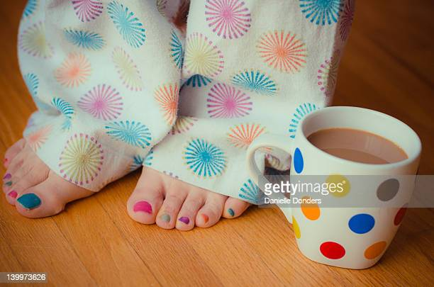 Colourful coffee cup, jammies and toes
