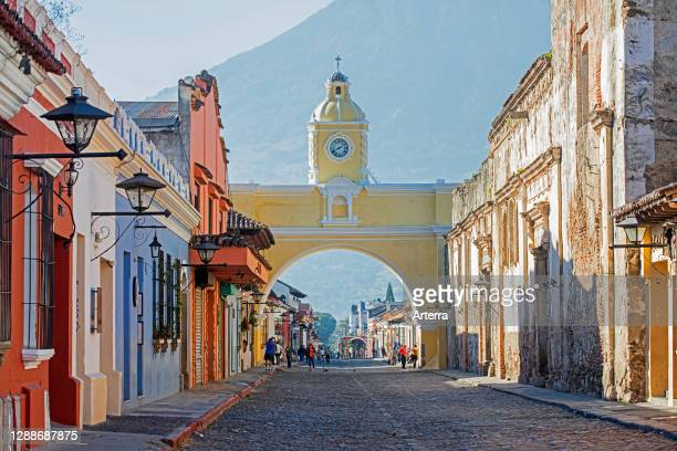 Colourful colonial houses and the 17th century Arco de Santa Catalina Arch in the city Antigua Guatemala, Sacatepequez Department, Guatemala.