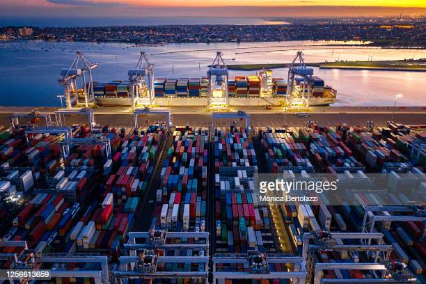 colourful containers in the port melbourne cargo area at nigh ttime - docks stock pictures, royalty-free photos & images