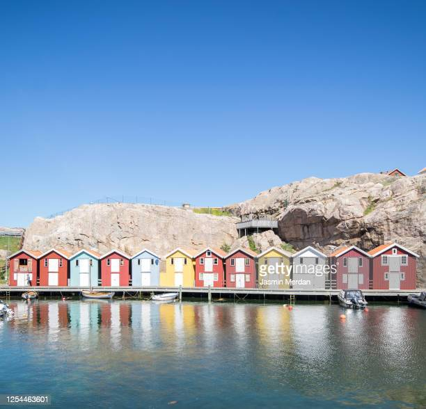 colourful cottages over water in scandinavia - gothenburg stock pictures, royalty-free photos & images
