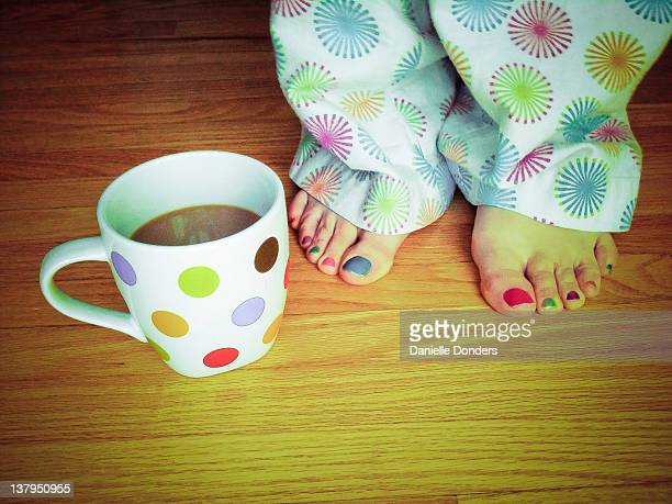 Colourful cup, toes and pajamas
