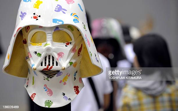 Colourful darth Vader helmet is displayed during the Star Wars Celebration Japan, a exhibition to celebrate the 30th anniversary of the Star Wars...