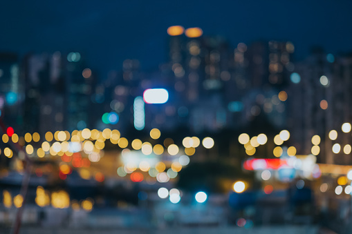 Colourful defocused lights of city skyline at night - gettyimageskorea