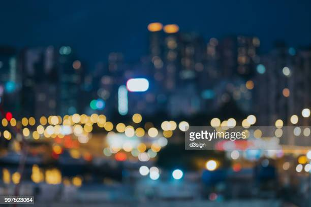 colourful defocused lights of city skyline at night - デフォーカス ストックフォトと画像