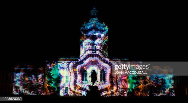 Colourful designs are projected on the facade of the Charlottenburg Palace as part of the yearly Festival of Lights in Berlin on September 14, 2020....