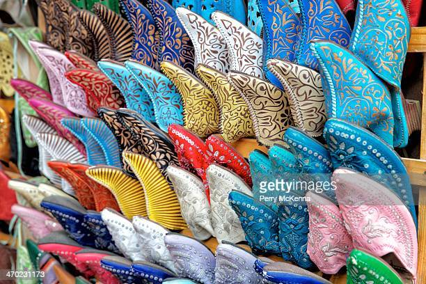Colourful display of Moroccan shoes in the market of Essaouira
