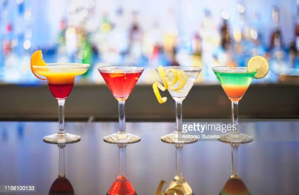 colourful drinks - martini glass stock pictures, royalty-free photos & images