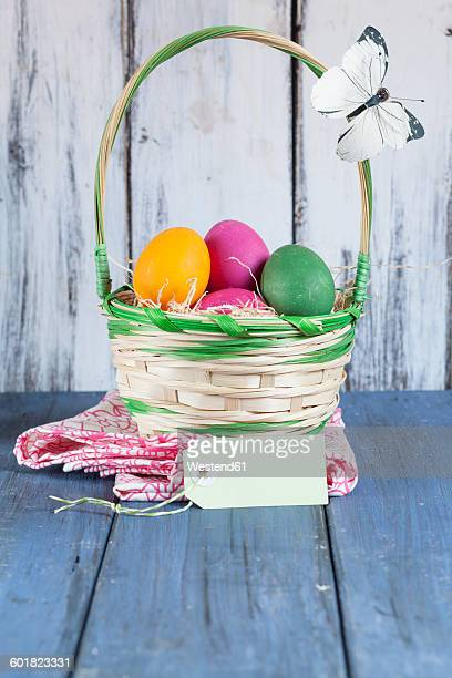 Colourful Easter basket with tag and butterfly decoartion