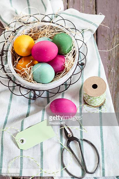 Colourful Easter basket with twine and tag