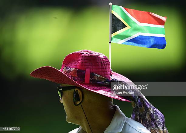 A colourful fan has the South African flag on his hat during the first round of the South African Open at Glendower Golf Club on January 8 2015 in...