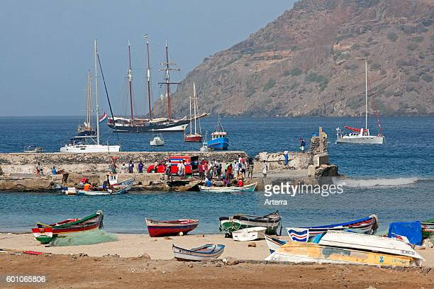 Colourful fishing boats and Creole fishermen in front of the threemasted topsail schooner Oosterschelde in the harbour of Tarrafal on the island...